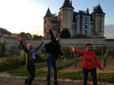 Amber, Florent and Fred jumping in front of the caste in Saumer